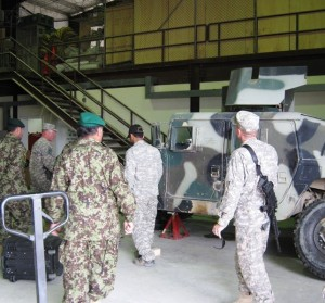 Working with Afghan National Army mechanics and logistics officers