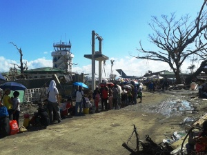 Thousands still waited in line at the Tacloban Airport on the ninth day following the typhoon