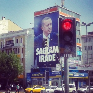 "Advertisement on an Ankara billboard for AKP, showing Erdoğan and the words ""Iron Will."""