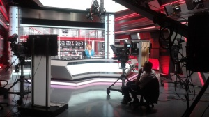 A tv journalist in between segments. Live at Bugün's studios in Istanbul.