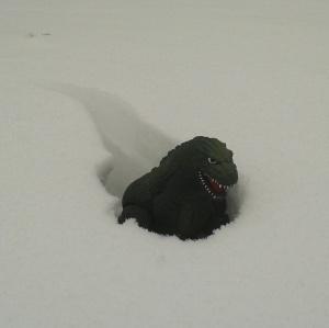 Godzilla examines snowfall levels in Greenpoint.